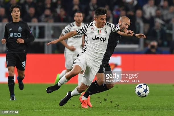 Paulo Dybala of Juventus is challenged by Andre Andre of FC Porto during the UEFA Champions League Round of 16 second leg match between Juventus and...