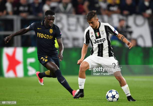 Paulo Dybala of Juventus is challenged by Benjamin Mendy of Monaco during the UEFA Champions League Semi Final second leg match between Juventus and...