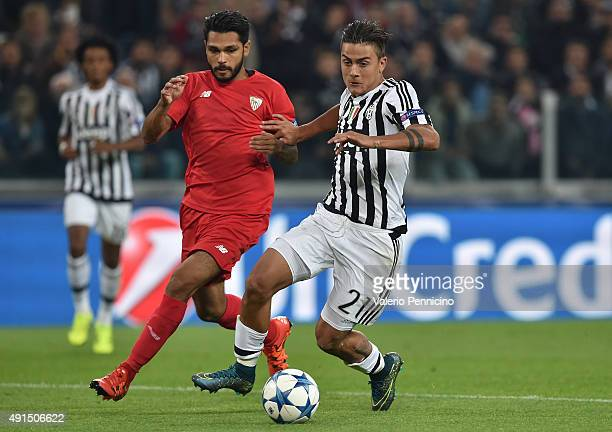 Paulo Dybala of Juventus is challenged by Benoit Tremoulinas of Sevilla during the UEFA Champions League group E match between Juventus and Sevilla...