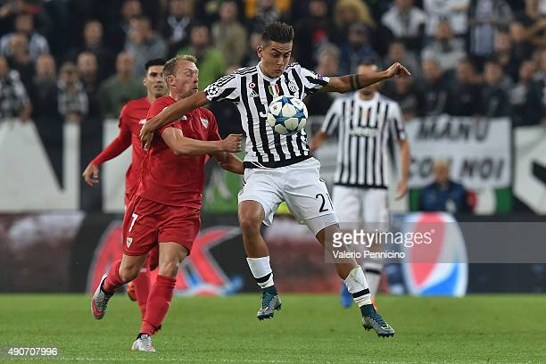 Paulo Dybala of Juventus is challenged by Michael KrohnDehli of Sevilla during the UEFA Champions League group E match between Juventus and Sevilla...