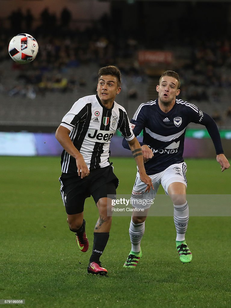 Paulo Dybala of Juventus is chased by Nick Ansell of Melbourne Victory during the 2016 International Champions Cup Australia match between Melbourne...