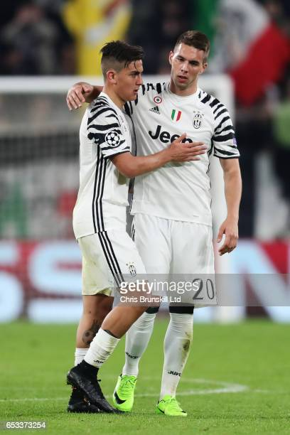 Paulo Dybala of Juventus is embraced by Marko Pjaca after being substituted during the UEFA Champions League Round of 16 second leg match between...