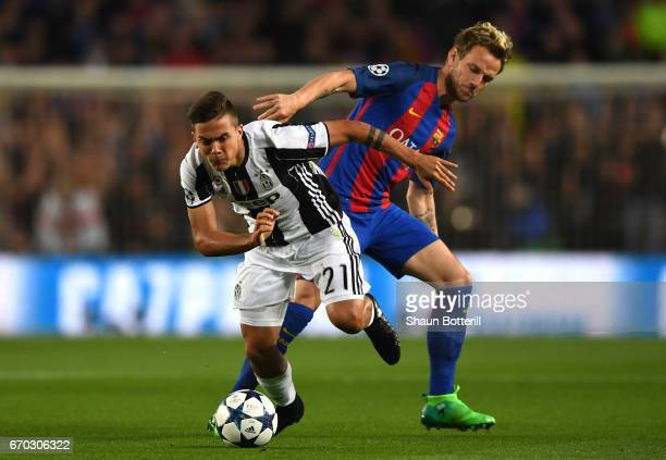 Paulo Dybala of Juventus is fouled by Ivan Rakitic of Barcelona during the UEFA Champions League Quarter Final second leg match between FC Barcelona...
