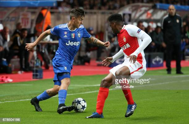 Paulo Dybala of Juventus Jesus Nascimento Jemerson of Monaco in action during the UEFA Champions League semi final first leg match between AS Monaco...