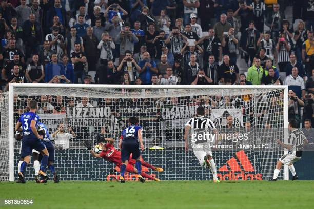 Paulo Dybala of Juventus kicks and fails to score a penalty during the Serie A match between Juventus and SS Lazio on October 14 2017 in Turin Italy