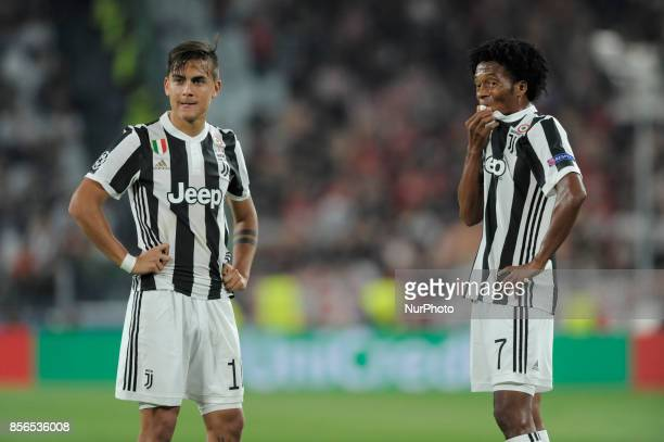 Paulo Dybala of Juventus player and Juan Cuadrado of Juventus player during the Uefa Champions League 20172018 match between FC Juventus and...