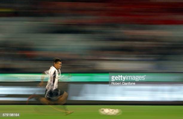 Paulo Dybala of Juventus runs with the ball during the 2016 International Champions Cup Australia match between Melbourne Victory FC and Juventus FC...