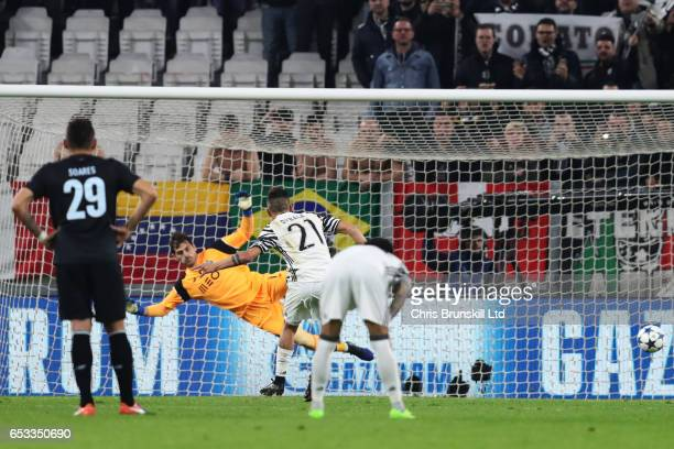 Paulo Dybala of Juventus scores a penalty past Iker Casillas of FC Porto to make the score 10 during the UEFA Champions League Round of 16 second leg...