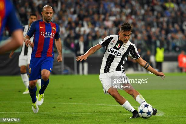 Paulo Dybala of Juventus scores his team's second goal during the UEFA Champions League Quarter Final first leg match between Juventus and FC...