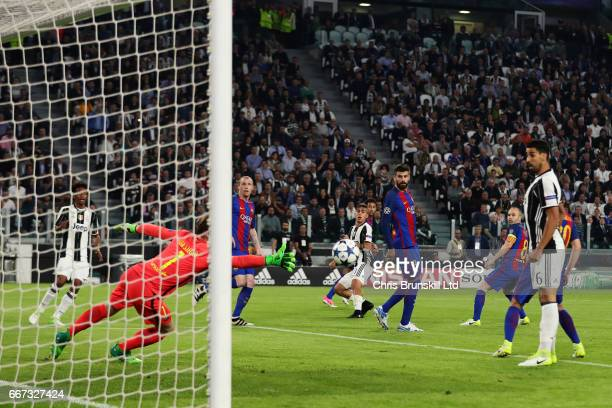 Paulo Dybala of Juventus scores the first goal to make the score 10 during the UEFA Champions League Quarter Final first leg match between Juventus...