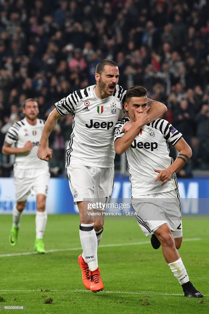 Paulo Dybala (R) of Juventus scores the opening goal with team mate Leonardo Bonucci during the UEFA Champions League Round of 16 second leg match between Juventus and FC Porto at Juventus Stadium on March 14, 2017 in Turin, Italy.