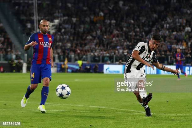 Paulo Dybala of Juventus scores the second goal to make the score 20 during the UEFA Champions League Quarter Final first leg match between Juventus...