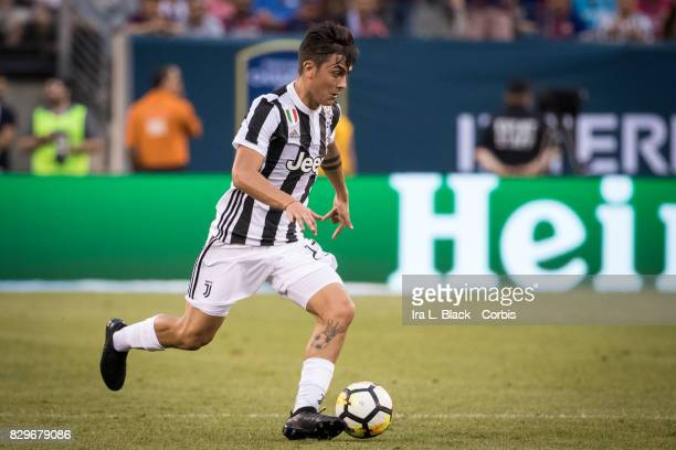 Paulo Dybala of Juventus takes the ball across the pitch during the International Champions Cup match between FC Barcelona and Juventus at the...