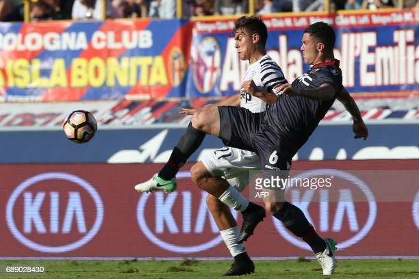Paulo Dybala of Juventus vies with Federico Viviani of Bologna during the Italian Serie A football match at the 'Renato Dall'ara' stadium in Bologna...