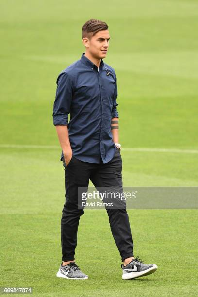 Paulo Dybala of Juventus walks on the pitch prior to the Juventus press conference at the Camp Nou on April 18 2017 in Barcelona Spain