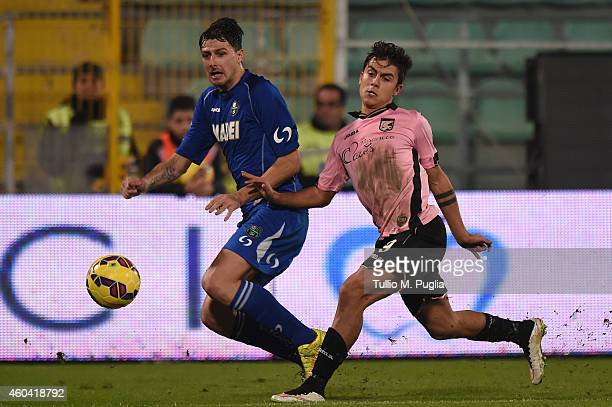 Paulo Dybala of Palermo and Francesco Acerbi of Sassulolo compete for the ball during the Serie A match between US Citta di Palermo and US Sassuolo...