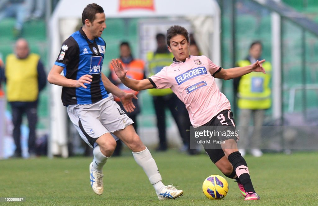 <a gi-track='captionPersonalityLinkClicked' href=/galleries/search?phrase=Paulo+Dybala&family=editorial&specificpeople=9572043 ng-click='$event.stopPropagation()'>Paulo Dybala</a> (R) of Palermo and Riccardo Cazzola of Atalanta compete for the ball during the Serie A match between US Citta di Palermo and Atalanta BC at Stadio Renzo Barbera on February 3, 2013 in Palermo, Italy.