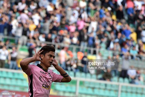 Paulo Dybala of Palermo celebrates after scoring a penalty during the Serie A match between US Citta di Palermo and AC Milan at Stadio Renzo Barbera...