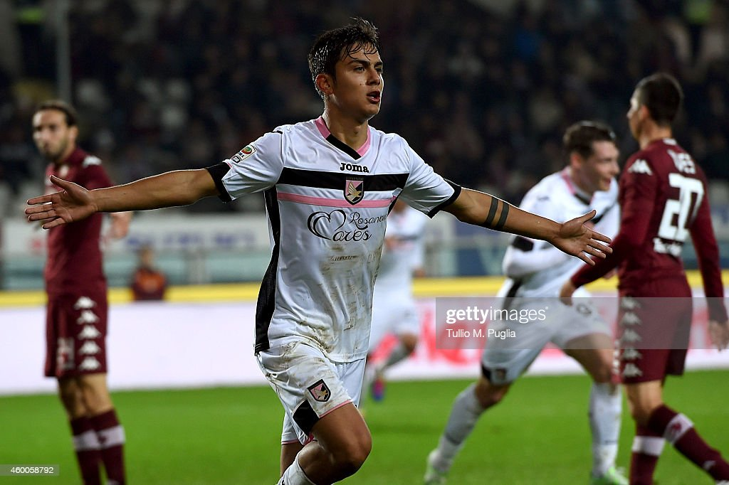 Paulo Dybala of Palermo celebrates after scoring his team's second goal during the Serie A match between Torino FC and US Citta di Palermo at Stadio Olimpico di Torino on December 6, 2014 in Turin, Italy.