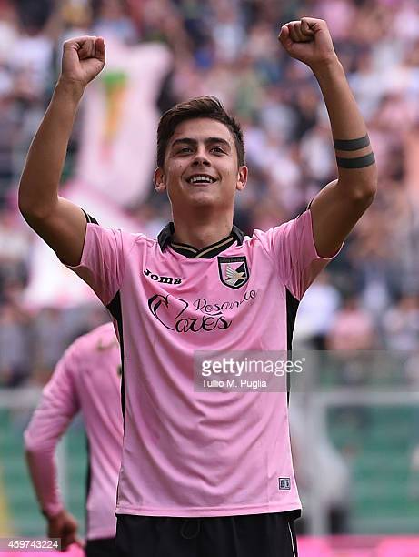 Paulo Dybala of Palermo celebrates after scoring the opening goal during the Serie A match between US Citta di Palermo and Parma FC at Stadio Renzo...