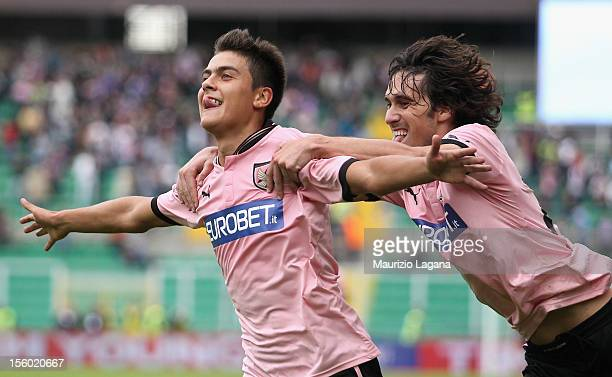 Paulo Dybala of Palermo celebrates after scoring the second goal with his teammate Santiago Garcia during the Serie A match between US Citta di...