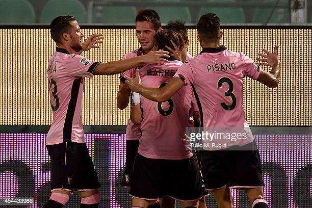 Paulo Dybala of Palermo celebrates with team mates after scoring the opening goal during the Serie A match between US Citta di Palermo and UC...