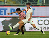 Paulo Dybala of Palermo competes for the ball with Kevin Strootman of Roma during the Serie A match between US Citta di Palermo and AS Roma at Stadio...