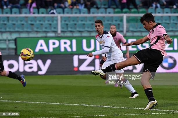 Paulo Dybala of Palermo scores his team's fourth goal during the Serie A match between US Citta di Palermo and Cagliari Calcio at Stadio Renzo...
