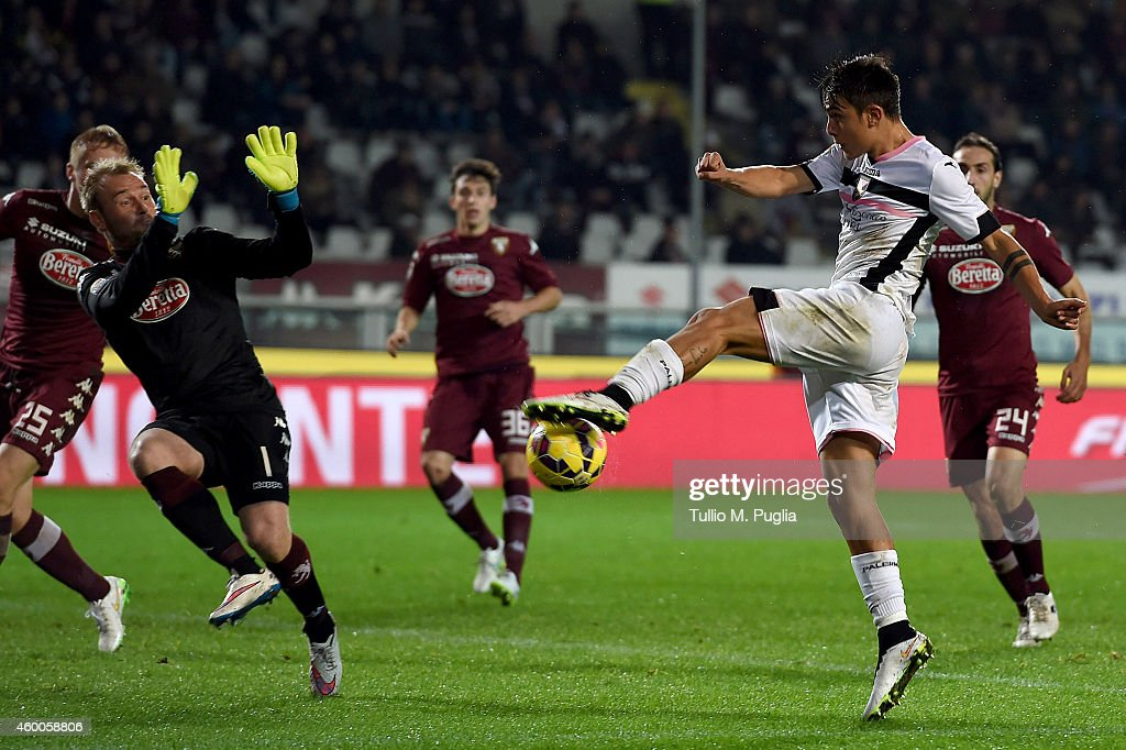 Paulo Dybala of Palermo scores his team's second goal during the Serie A match between Torino FC and US Citta di Palermo at Stadio Olimpico di Torino on December 6, 2014 in Turin, Italy.