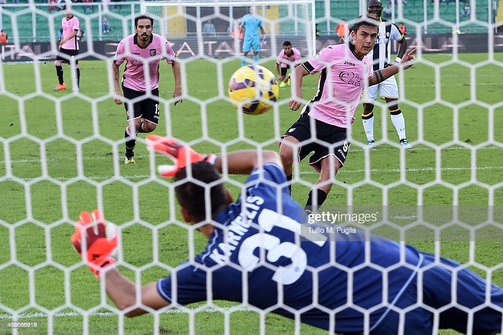 Paulo Dybala of Palermo scores the equalizing goal during the Serie A match between US Citta di Palermo and Udinese Calcio at Stadio Renzo Barbera on...