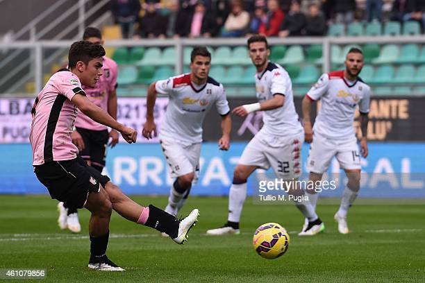 Paulo Dybala of Palermo scores their third goal from the penalty spot during the Serie A match between US Citta di Palermo and Cagliari Calcio at...