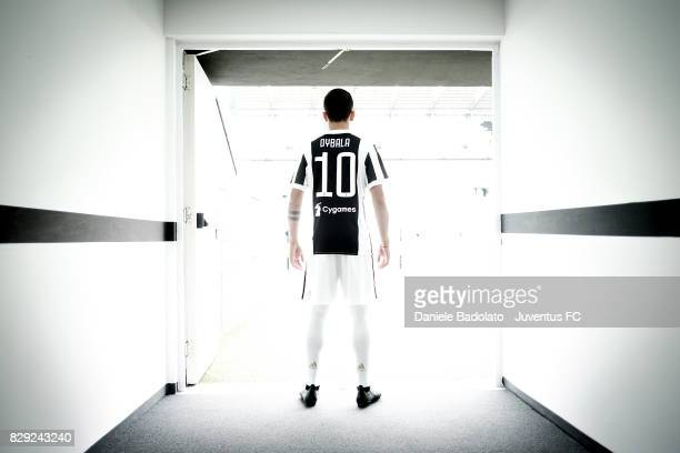 Paulo Dybala poses with his new Juventus shirt on August 10 2017 in Turin Italy