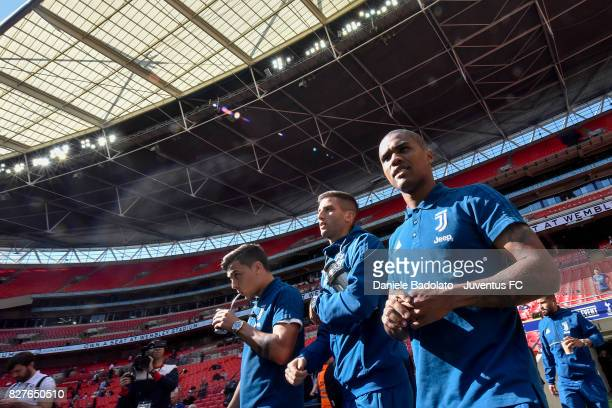 Paulo Dybala Rodrigo Bentancur and Douglas Costa before the Tottenham Hotspur v Juventus PreSeason Friendly match at Wembley Stadium on August 5 2017...