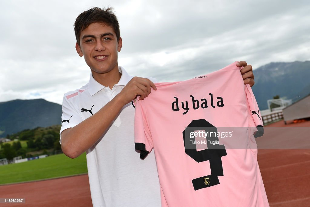 Paulo Dybala shows his new shirt during his presentation as the club's new signing after a US Citta di Palermo preseason training session at Sport...