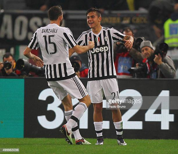Paulo Dybala with his teammate Gorgio Chiellini of Juventus FC celebrates after scoring the team's second goal during the Serie A match between SS...