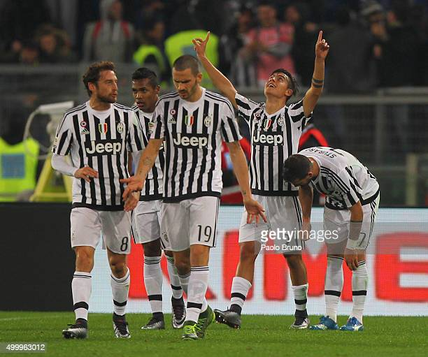 Paulo Dybala with his teammates of Juventus FC celebrates after scoring the team's second goal during the Serie A match between SS Lazio and Juventus...