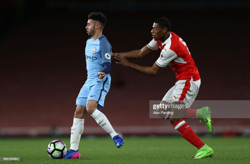 Paulo Fernandes of Manchester City is put under pressure by Jeff Reine-Adelaide of Arsenal during the Premier League 2 match between Arsenal and Manchester City at Emirates Stadium on March 13, 2017 in London, England.