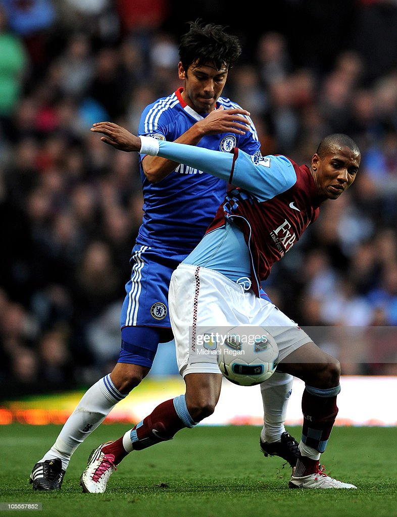 <a gi-track='captionPersonalityLinkClicked' href=/galleries/search?phrase=Paulo+Ferreira+-+Soccer+Player&family=editorial&specificpeople=185237 ng-click='$event.stopPropagation()'>Paulo Ferreira</a> of Chelsea battles for the ball with <a gi-track='captionPersonalityLinkClicked' href=/galleries/search?phrase=Ashley+Young&family=editorial&specificpeople=623155 ng-click='$event.stopPropagation()'>Ashley Young</a> of Aston Villa during the Barclays Premier League match between Aston Villa and Chelsea at Villa Park on October 16, 2010 in Birmingham, England.