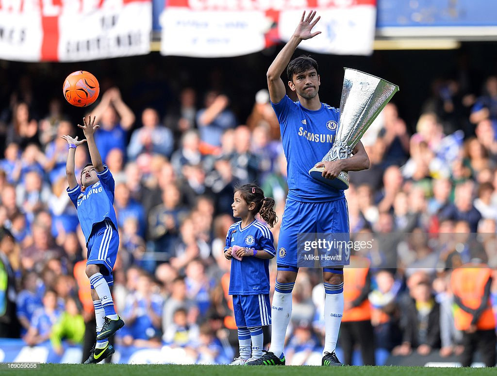 Paulo Ferreira of Chelsea holds aloft the UEFA Europa League trophy as he celebrates on the pitch after the Barclays Premier League match between Chelsea and Everton at Stamford Bridge on May 19, 2013 in London, England.