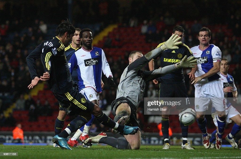 <a gi-track='captionPersonalityLinkClicked' href=/galleries/search?phrase=Paulo+Ferreira+-+Soccer+Player&family=editorial&specificpeople=185237 ng-click='$event.stopPropagation()'>Paulo Ferreira</a> of Chelsea scores his team's third goal during the Carling Cup Quarter Final match between Blackburn Rovers and Chelsea at Ewood Park on December 2, 2009 in Blackburn, England.