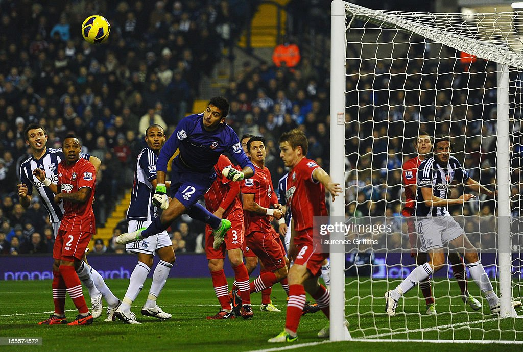 Paulo Gazzaniga of Southampton punches clear undwer pressure during the Barclays Premier League match between West Bromwich Albion and Southampton at The Hawthorns on November 5, 2012 in West Bromwich, England.
