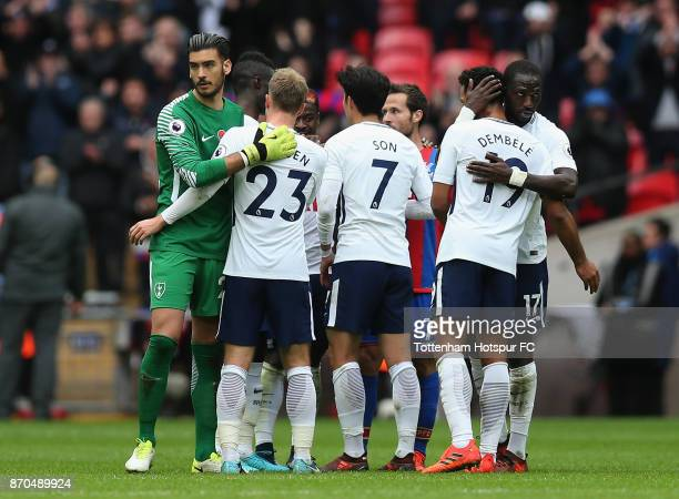 Paulo Gazzaniga of Tottenham Hotspur and Christian Eriksen of Tottenham Hotspur embrace after the Premier League match between Tottenham Hotspur and...