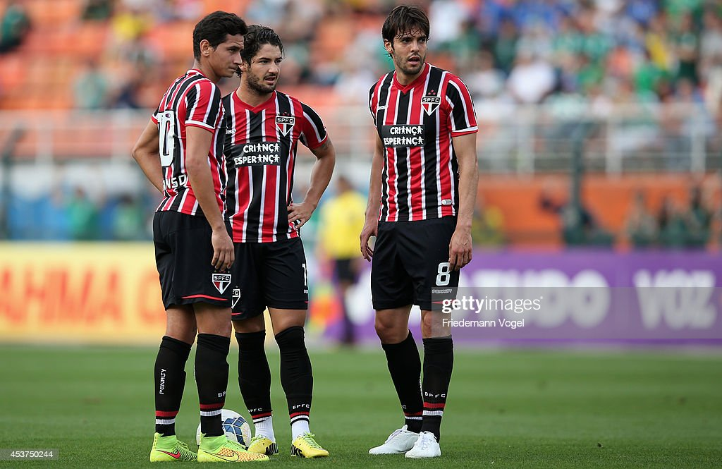 Paulo Henrique Ganso Pato and Kaka of Sao Paulo looks on during the match between Palmeiras and Sao Paulo for the Brazilian Series A 2014 at Estadio...