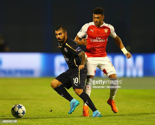 Paulo Machado of Dinamo Zagreb is closed down by Alex OxladeChamberlain of Arsenal during the UEFA Champions League Group F match between Dinamo...