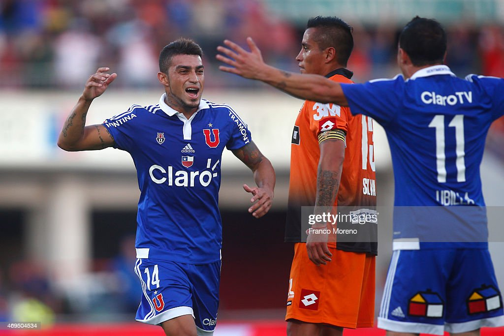 Paulo Magalhaes of Universidad de Chile celebrates with his teammate Sebastian Ubilla after scoring the second goal of his team during a match between U de Chile and Cobreloa as a part of fourteenth round of Torneo Scotiabank Clausura 2015 at Nacional Julio Martinez Pradanos Stadium on April 11, 2015, in Santiago, Chile.