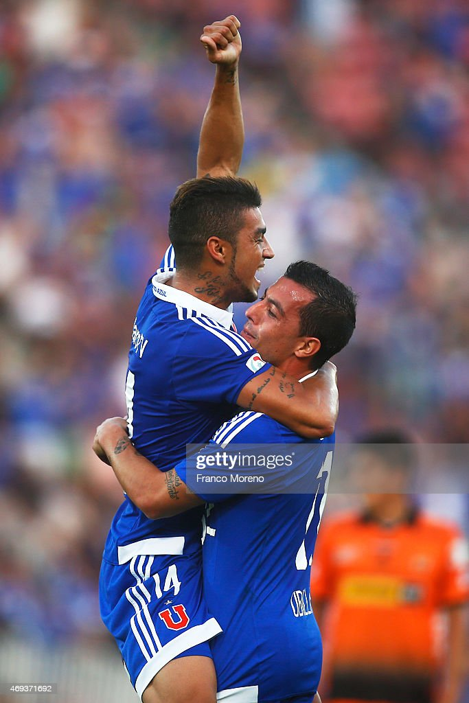 Paulo Magalhaes of Universidad de Chile celebrates with teammate Sebastian Ubilla after scoring the second goal of his team during a match between U de Chile and Cobreloa as part of fourteenth round of Torneo Scotiabank Clausura 2015 at Nacional Julio Martinez Pradanos Stadium on April 11, 2015, in Santiago, Chile.
