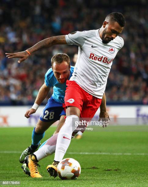 Paulo Miranda of Red Bull Salzburg is challenged by Valere Germain of Marseille during the UEFA Europa League group I match between RB Salzburg and...