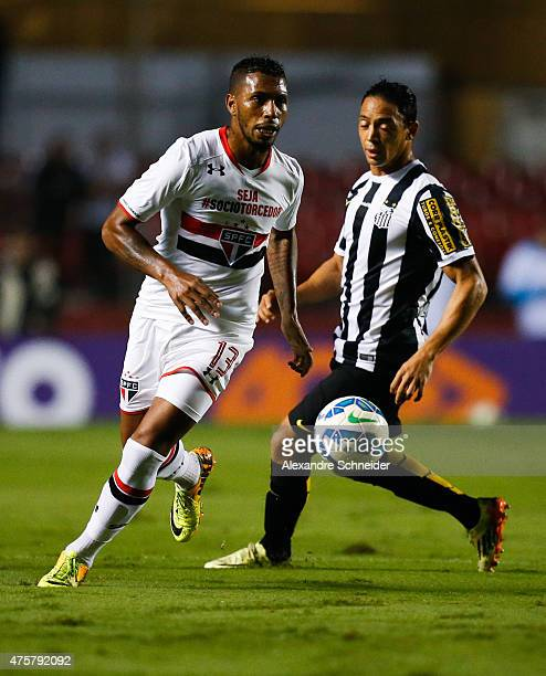 Paulo Miranda of Sao Paulo and Ricardo Oliveira of Santos in action during the match between Sao Paulo and Santos for the Brazilian Series A 2015 at...