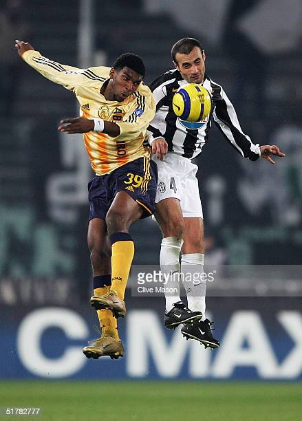 Paulo Montero of Juventus is challenged by Ryan Babel of Ajax during the UEFA Champions League Group C match between Juventus and Ajax at the Stadio...