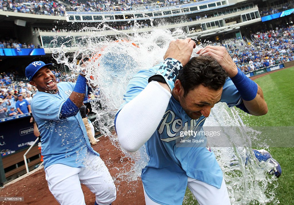 <a gi-track='captionPersonalityLinkClicked' href=/galleries/search?phrase=Paulo+Orlando&family=editorial&specificpeople=4406041 ng-click='$event.stopPropagation()'>Paulo Orlando</a> #16 of the Kansas City Royals is doused with water by catcher Salvador Perez #13 after hitting a walk-off grand slam in the bottom of the 9th inning during game 1 of a double-header against the Tampa Bay Rays at Kauffman Stadium on July 7, 2015 in Kansas City, Missouri. The Royals defeated the Tampa Bay Rays 9-5 to win the game.